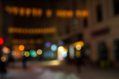 People moving on old city winter night street blurred Royalty Free Stock Photos