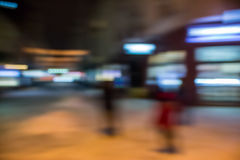 People moving on old city winter night street blurred Stock Photo