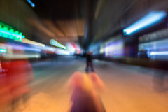 People moving on old city winter night street blurred Stock Image