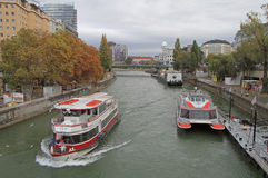 People are moving in ships by canal in Vienna, Austria Royalty Free Stock Images