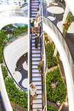 People on moving staircase Royalty Free Stock Image