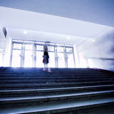 People moving on steps Stock Photo