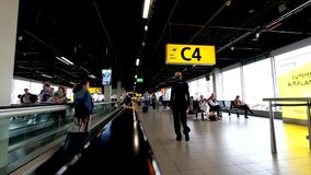 People moving to departure gates in international Schiphol airport stock footage