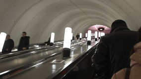 People moving up on the escalator in Moscow metro. Moscow, Russian Federation – February 05, 2016: People moving up on the escalator in Moscow metro stock video footage