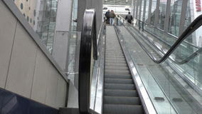 People moving up on escalator. People standing on the escalator are moving up stock video