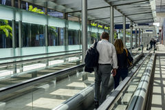 People on a moving walkway Stock Photography