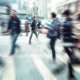 People moving on zebra crosswalk at crowded city. Hong Kong. Blurred image of people moving in crowded night city street. Art toning abstract urban background stock photos