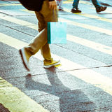 People moving on zebra crosswalk at crowded city. Hong Kong Royalty Free Stock Images