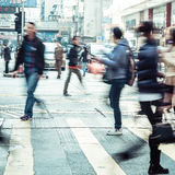 People moving on zebra crosswalk at crowded city. Hong Kong Stock Photography