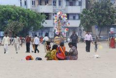 People at Mumbai beach. A family and people walking at Mumbai beach Stock Photos