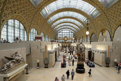 People in Musee d'Orsay, Paris. Paris, France - September 12, 2013: People in the Musee d'Orsay in Paris, France on September 12, 2013. Opened in 1986, the Stock Image