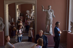People in the museum of ancient sculpture Stock Photos