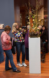 People in museum. Bouquets to Art exhibition. Royalty Free Stock Image