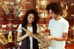 People in musical shop Royalty Free Stock Photos