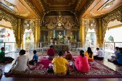 People in Myanmar temple Yangon royalty free stock images
