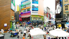 People at Myeong-dong fashions district stock footage