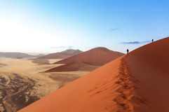 People on Namib desert dunes, travel in Africa royalty free stock photography