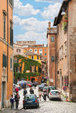 People on the narrow picturesque street in Rome, Italy Royalty Free Stock Photography