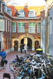 People on the narrow street in the Dutch town Den Bosch. Royalty Free Stock Image