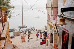 People on a narrow street goes to the river Ganges Stock Photo