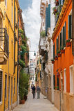 People on a narrow street in Venice, Italy Stock Image