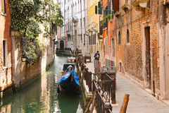 People on a narrow street in Venice, Italy Stock Photo