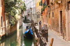People on a narrow street in Venice, Italy Stock Photo