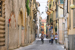People on a narrow street in Verona, Italy Stock Photo