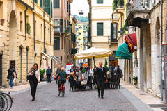 People on a narrow street in Verona, Italy Royalty Free Stock Image