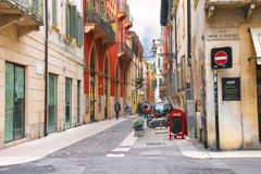 People on a narrow street in Verona, Italy Royalty Free Stock Photos
