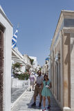 People in the narrow streets of Santorini Royalty Free Stock Images