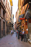 People in the narrow Via Drapperie in Bologna. Italy. Bologna, Italy - August 18, 2014: People in the narrow Via Drapperie in Bologna. Italy Stock Images