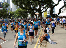 People at national sports event, Singapore. Singaporean people in blue sports dress  participate in a public, nation-wide, marathon sports event, taking place in Stock Photography
