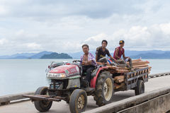 People native driving tractor. RANONG, THAILAND-2 JUNE 2014: people native driving tractor delivers a load of lumber to Kon Phayam village (Koh Phayam island) Royalty Free Stock Images