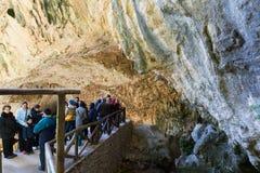 People at natural grot. Cuerva dal Agua. JAEN, SPAIN - DECEMBER 7, 2014:  People at natural grot. Cuerva dal Agua near Tiscar. Provincia de Jaen Stock Photo