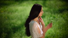 Woman with wild flowers stock footage