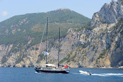 People navigating their boat from Portovenere to Cinque Terre Royalty Free Stock Image