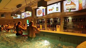 People near bar inside water park stock video