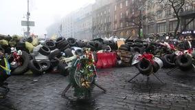 People near barricades on the Khreshchatyk street. UKRAINE, KIEV, MARCH 4, 2014: Political crisis. People near barricades on the Khreshchatyk street - main stock video