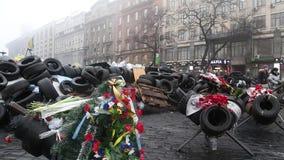 People near barricades on the Khreshchatyk street. UKRAINE, KIEV, MARCH 4, 2014: Political crisis. People near barricades on the Khreshchatyk street - main stock footage