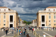 People near the Basilica di San Pietro from the Via della Concil Royalty Free Stock Photography