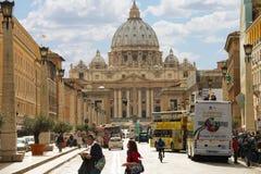 People near the Basilica di San Pietro from the Via della Concil Stock Photo