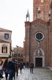 People near Basilica Frari in Venice city. VENICE, ITALY - MARCH 30, 2017: people near Basilica di santa maria gloriosa dei frari The Frari. The Church is one of royalty free stock image