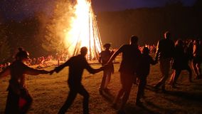 People near the bonfire celebrate the feast of Ivan Kupala Day stock video