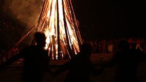 People near the bonfire celebrate the feast of Ivan Kupala Day stock video footage