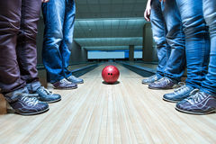 People near bowling ball. Many people standing near bowling ball on the lane Royalty Free Stock Photography