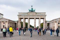 People near Brandenburg gate in Berlin in autumn. BERLIN, GERMANY - SEPTEMBER 13, 2017: people near Brandenburg gate Brandenburger Tor in Berlin city in stock photos