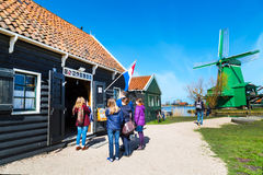 People near Cacaolab shop and windmill in Zaanse Schans, traditional village, Netherlands, Holland Royalty Free Stock Photography