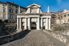 People near city gates of San Marco in Bergamo town, Italy. Royalty Free Stock Photo