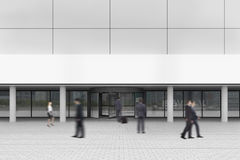 People near a corporate building entrance Royalty Free Stock Photo